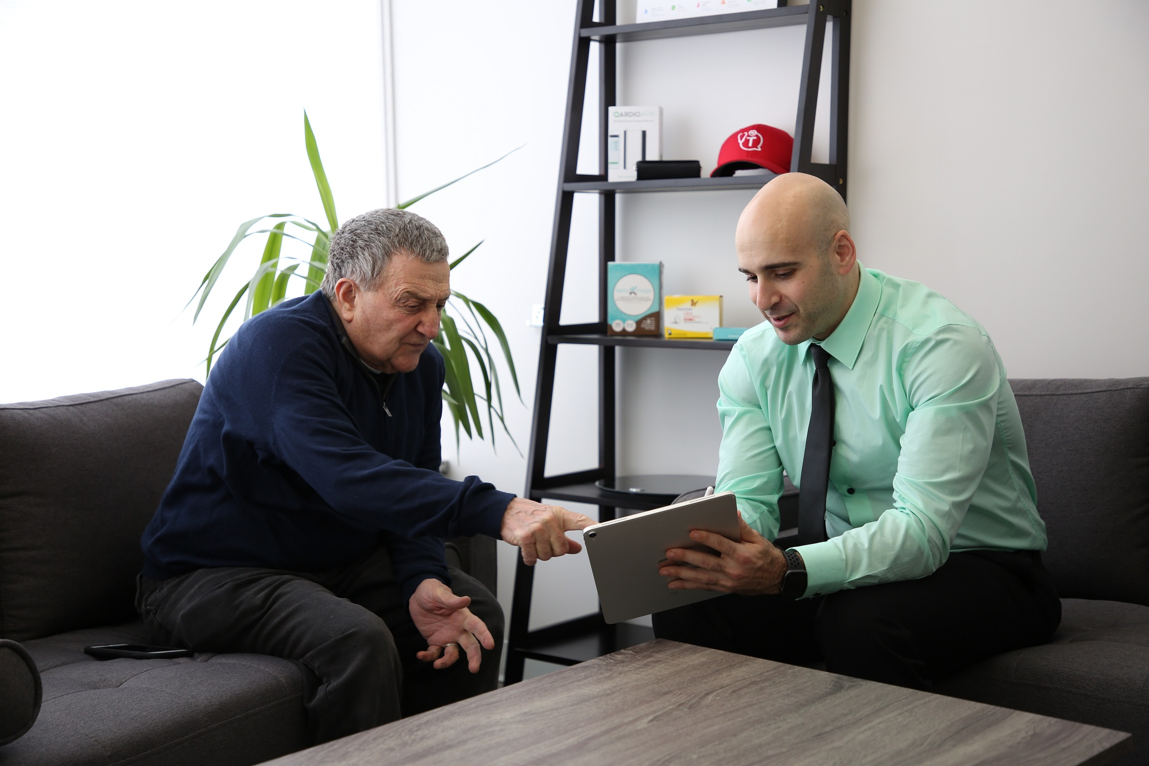 Dr. Tro Kalayjian consults with a patient in his office prior to the COVID-19 threat. Kalayjian's office is fully equipped to treat patients using remote monitoring tools, ensuring continuity of care.